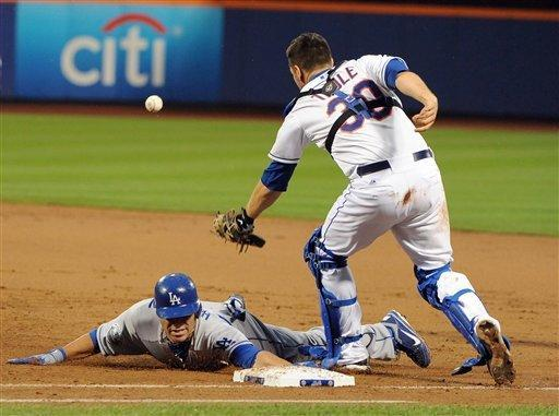 Los Angeles Dodgers second baseman Jerry Hairston Jr. (6) is safe at first base after New York Mets catcher Josh Thole (30) misses the throw from Ike Davis in the third inning of a baseball game on Firday, July 20, 2012, at Citi Field in New York. (AP Photo/Kathy Kmonicek)