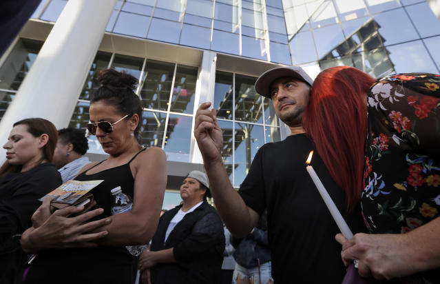 <p>Joe Thomas hugs Elizabeth Reitz, right, during a vigil at City Hall in Las Vegas, Monday, Oct. 2, 2017. The vigil was held in honor of the over 50 people killed and hundreds injured in a mass shooting at an outdoor music concert late Sunday. (Photo: Gregory Bull/AP) </p>