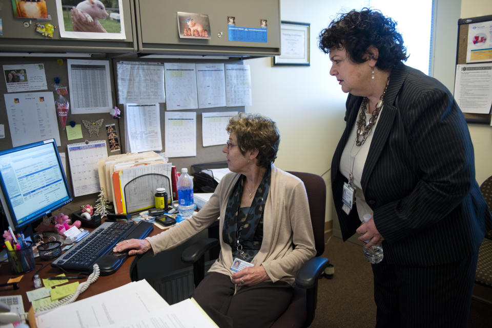 Lauren Peters, Director of Women's Health for Kaiser Permanente Outpatient Clinics in part of Sacramento, California, confers with business ine manager Sherwood Sterling. Peters does not plan on tapping in to her company's pension plan for at least a decade, probably more. (Autumn Payne/Sacramento Bee/Tribune News Service via Getty Images)