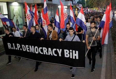An informal group protests in the town of Mostar against the election of a moderate Croat in Bosnia's tripartite inter-ethnic presidency