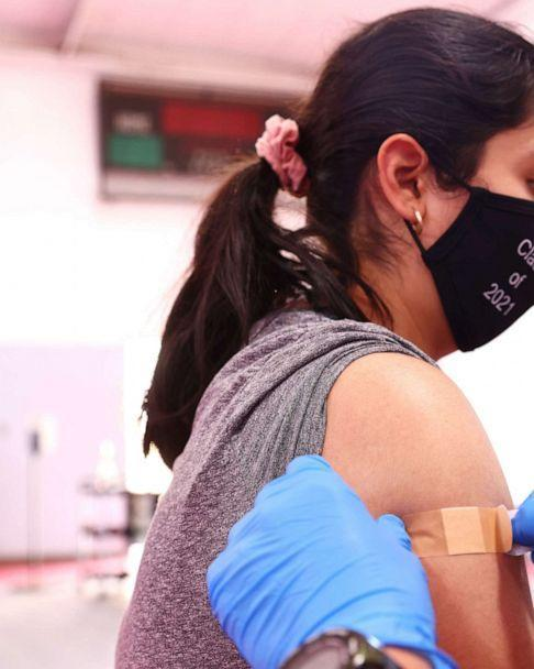 PHOTO: A student wearing a 'Class of 2021' face mask is bandaged after receiving a dose of a COVID-19 vaccine at a pop-up vaccination clinic at James Jordan Middle School in Winnetka, California, on July 6, 2021. (Mario Tama/Getty Images)
