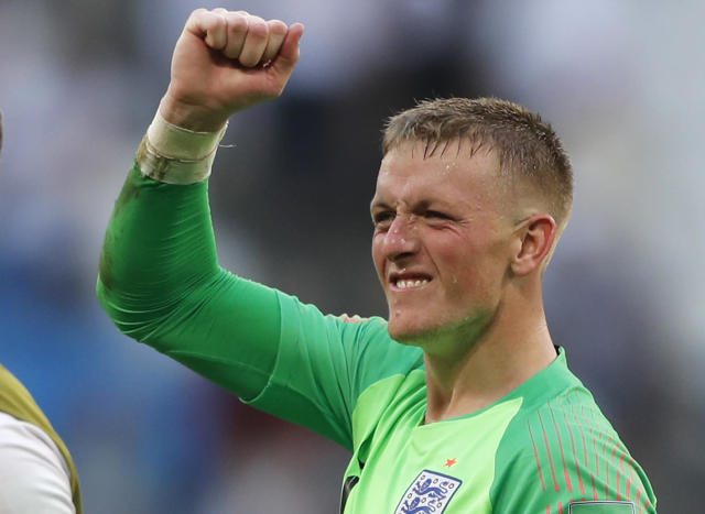 England goalkeeper Jordan Pickford celebrates victory of his team over Sweden during the quarterfinal match between Sweden and England at the 2018 soccer World Cup in the Samara Arena, in Samara, Russia, Saturday, July 7, 2018. (AP Photo/Frank Augstein)