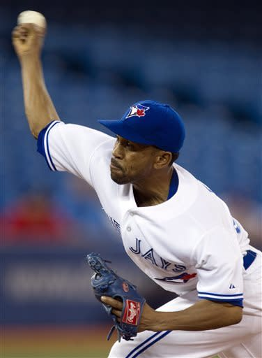 Toronto Blue Jays starting pitcher Ramon Ortiz pitches to the Tampa Bay Rays during the first inning of a baseball in Toronto on Tuesday May 21, 2013. )AP Photo/The Canadian Press, Frank Gunn)