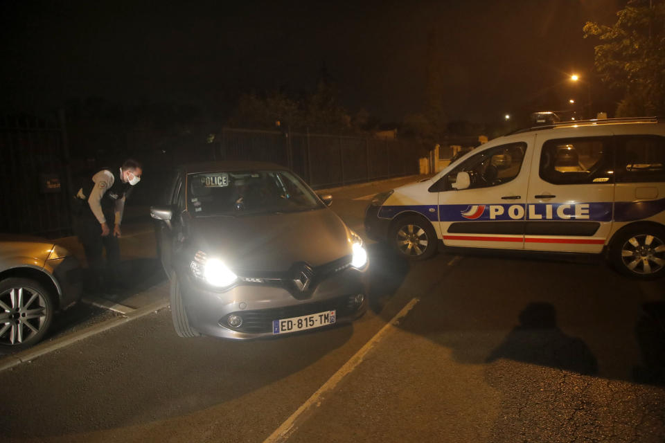 Police officers block the access after a history teacher who opened a discussion with students on caricatures of Islam's Prophet Muhammad was decapitated in a French street on Friday and police have shot the suspected killer dead, Friday, Oct. 16, 2020 in Conflans-Saint-Honorine, north of Paris. (AP Photo/Michel Euler)
