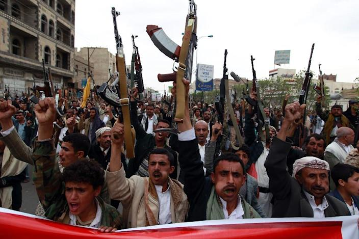 Yemeni supporters of the Shiite Huthi rebel movement raise their weapons during a rally to protest against a military offensive by a Saudi-led coalition, on August 11, 2015 in the capital Sanaa (AFP Photo/Mohammed Huwais)