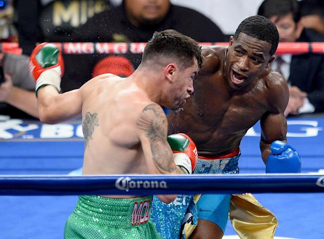 LAS VEGAS, NV - MAY 03: (R-L) Adrian Broner throws a right at Carlos Molina during their super lightweight bout at the MGM Grand Garden Arena on May 3, 2014 in Las Vegas, Nevada. (Photo by Ethan Miller/Getty Images)