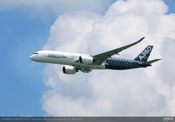 An Airbus A350 in flight, with a cloud in the background