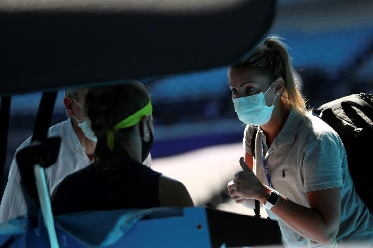 Karolina Muchova receives medical attention during the second set against Ashleigh Barty