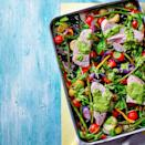 """<p>Let your oven do the work with this simple, colourful recipe.</p><p><strong>Recipe: <a href=""""https://www.goodhousekeeping.com/uk/food/recipes/a35564487/tuna-traybake-with-salsa-verde-dressing/"""" rel=""""nofollow noopener"""" target=""""_blank"""" data-ylk=""""slk:Tuna Traybake with Salsa Verde Dressing"""" class=""""link rapid-noclick-resp"""">Tuna Traybake with Salsa Verde Dressing</a></strong></p>"""