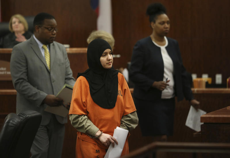 In this May 5, 2015 photo, Nadia Irsan, who is accused of stalking her sister, her sister's husband, and her best friend, whom were gunned down in 2013, appears in the 184th State District Court at the Harris County Criminal Courthouse in Houston. Special prosecutors on Wednesday, Nov. 20, 2019, have charge Irsan with conspiring with her father, stepmother and brother in the family-run criminal plan that led to the 2012 fatal shootings. ( Mayra Beltran/Houston Chronicle via AP)