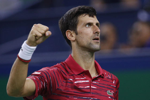Novak Djokovic of Serbia reacts as he plays against Denis Shapovalov of Canada in the men's singles match at the Shanghai Masters tennis tournament at Qizhong Forest Sports City Tennis Center in Shanghai, China, Wednesday, Oct. 9, 2019. (AP Photo/Andy Wong)