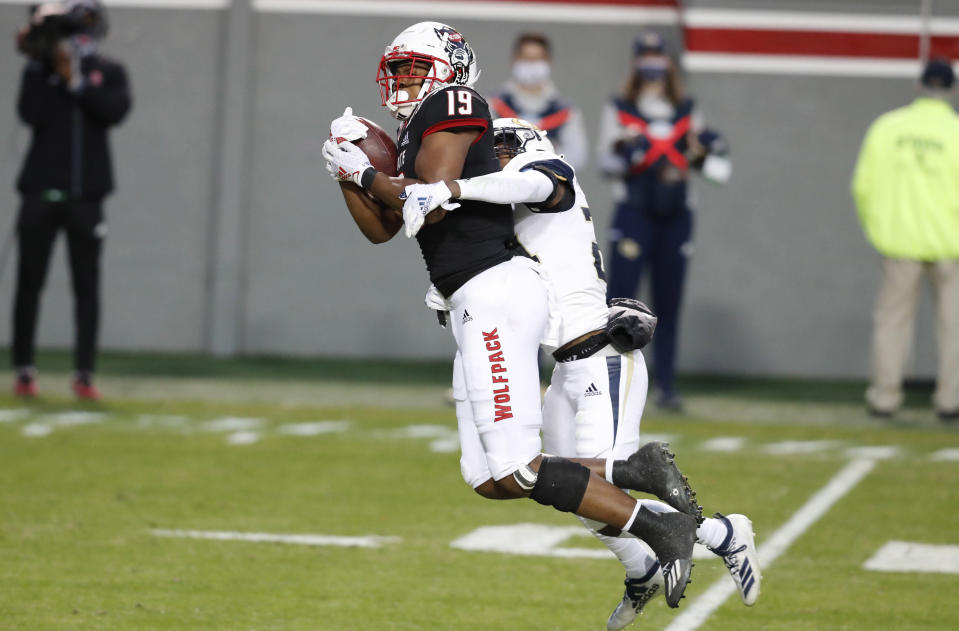 North Carolina State wide receiver C.J. Riley (19) pulls in a reception while defended by Georgia Tech defensive back Kenan Johnson (24) during the first half of an NCAA college football game in Raleigh, N.C., Saturday, Dec. 5, 2020. (Ethan Hyman/The News & Observer via AP, Pool)