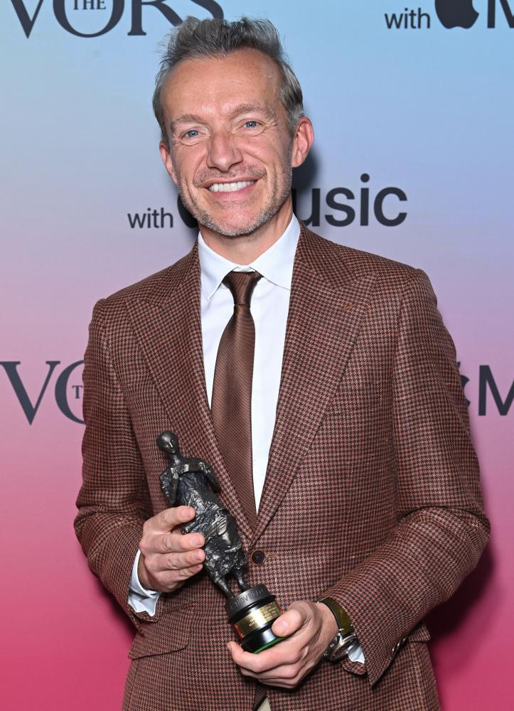Fraser T Smith with the best contemporary song trophy he won with Dave at the Ivor Novello Awards on 21 September.