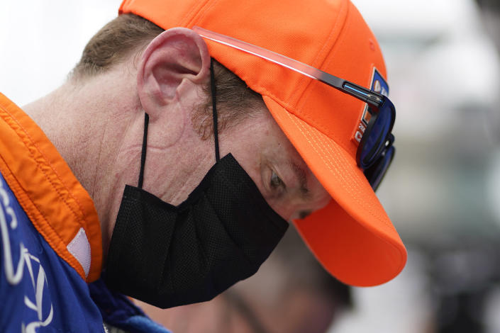 Scott Dixon, of New Zealand, looks at his practice speeds during practice for the Indianapolis 500 auto race at Indianapolis Motor Speedway, Wednesday, May 19, 2021, in Indianapolis. (AP Photo/Darron Cummings)