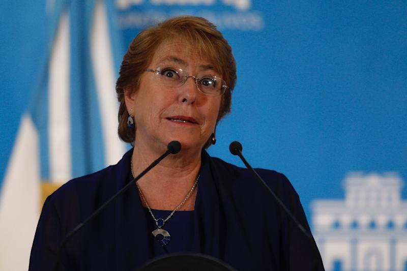 Chile's President Michelle Bachelet gestures during in Olivos, Buenos Aires province, on December 16, 2016