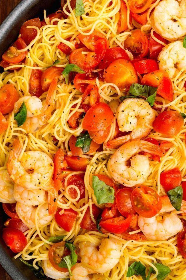 """<p>You're going to be making this satisfying <a href=""""https://www.delish.com/uk/cooking/recipes/g32331046/prawn-recipes/"""" rel=""""nofollow noopener"""" target=""""_blank"""" data-ylk=""""slk:prawn"""" class=""""link rapid-noclick-resp"""">prawn</a> pasta all summer long.</p><p>Get the <a href=""""https://www.delish.com/uk/cooking/recipes/a32808431/bruschetta-shrimp-pasta-recipe/"""" rel=""""nofollow noopener"""" target=""""_blank"""" data-ylk=""""slk:Bruschetta Prawn Pasta"""" class=""""link rapid-noclick-resp"""">Bruschetta Prawn Pasta</a> recipe.</p>"""