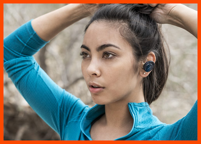Lost in her music—these earbuds are a dream. (Photo: Bose)