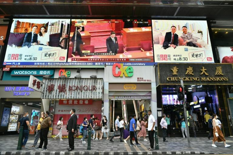 China's President Xi Jinping is shown on a large video screen in Hong Kong -- a new national security law for the city has raised hackles in the territory and abroad (AFP Photo/Anthony WALLACE)