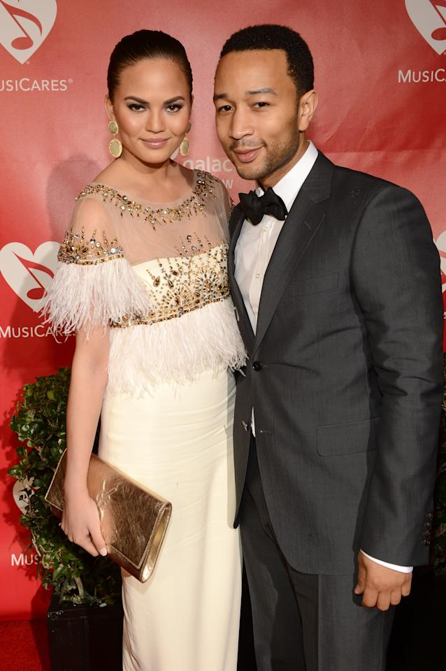 LOS ANGELES, CA - FEBRUARY 08:  Model Christine Teigen (L) and singer John Legend arrive at MusiCares Person Of The Year Honoring Bruce Springsteen at Los Angeles Convention Center on February 8, 2013 in Los Angeles, California.  (Photo by Larry Busacca/Getty Images for NARAS)