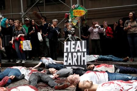 Climate change activists protest on Wall St in Lower Manhattan during Extinction Rebellion protests in New York City, New York