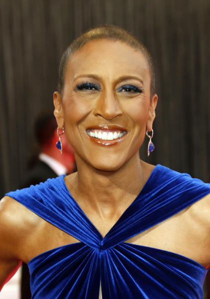 "File-This Feb. 24, 2013 file photo shows broadcaster Robin Roberts arriving at the 85th Academy Awards at the Dolby Theatre in Los Angeles. Roberts thanked her longtime girlfriend, Amber Laign, in a year-end post published on the ABC News anchor's Facebook page on Sunday, Dec. 29, 2013. The message comes after Roberts' battle with a life-threatening illness. This is the first time the ""Good Morning America"" anchor has publicly acknowledged her 10-year, same-sex relationship with Laign, a massage therapist from the San Francisco Bay Area, who focuses on patients recovering from injuries. (Photo by Todd Williamson/Invision/AP, File)"