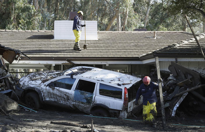 <p>Emergency crew members search an area damaged by storms in Montecito, Calif., Friday, Jan. 12, 2018. (Photo: Marcio Jose Sanchez/AP) </p>