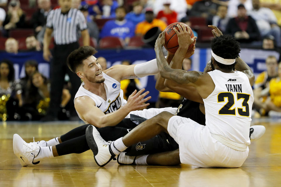 <p>Sean Mobley #5 and Issac Vann #23 of the Virginia Commonwealth Rams battles for the ball with Aubrey Dawkins #15 of the UCF Knights in the second half during the first round of the 2019 NCAA Men's Basketball Tournament at Colonial Life Arena on March 22, 2019 in Columbia, South Carolina. (Photo by Kevin C. Cox/Getty Images) </p>