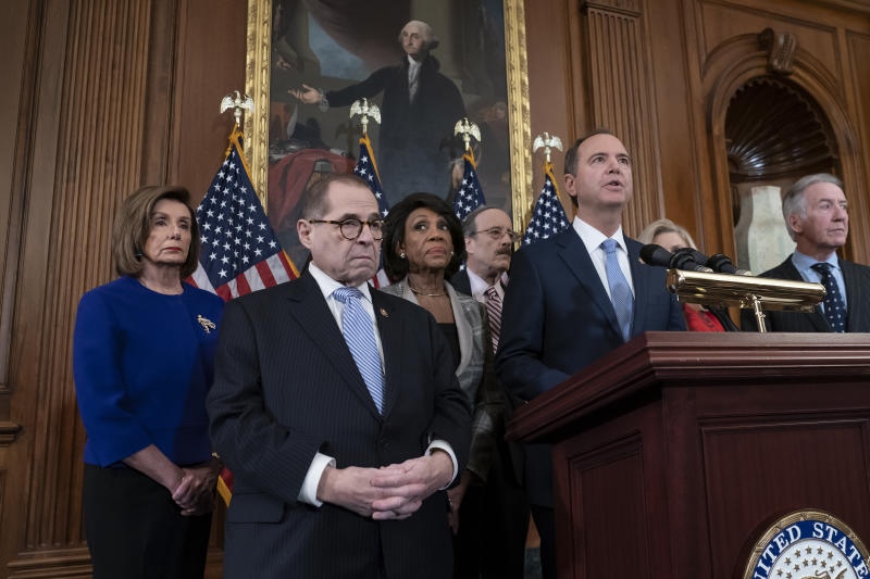 From left, Speaker of the House Nancy Pelosi, D-Calif., House Judiciary Committee Chairman Jerrold Nadler, D-N.Y., House Financial Services Committee Chairwoman Maxine Waters, D-Calif., House Foreign Affairs Committee Chairman Eliot Engel, D-N.Y., House Intelligence Committee Chairman Adam Schiff, D-Calif., and House Ways and Means Committee Chairman Richard Neal, D-Mass., announce they are pushing ahead for two articles of impeachment against President Donald Trump — abuse of power and obstruction of Congress — charging he corrupted the U.S. election process and endangered national security in his dealings with Ukraine, at the Capitol in Washington, Tuesday, Dec. 10, 2019. (AP Photo/J. Scott Applewhite)