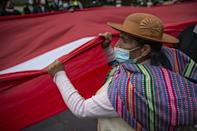 Rural supporters of Pedro Castillo march outside Peru's national election office in a show of support for their presidential candidate