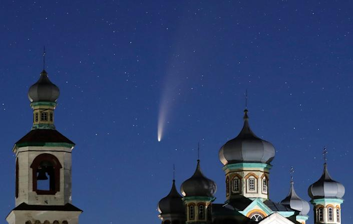 Comet Neowise is seen behind an Orthodox church over the Turets, Belarus, 69 miles west of capital Minsk, early Tuesday, July 14, 2020.