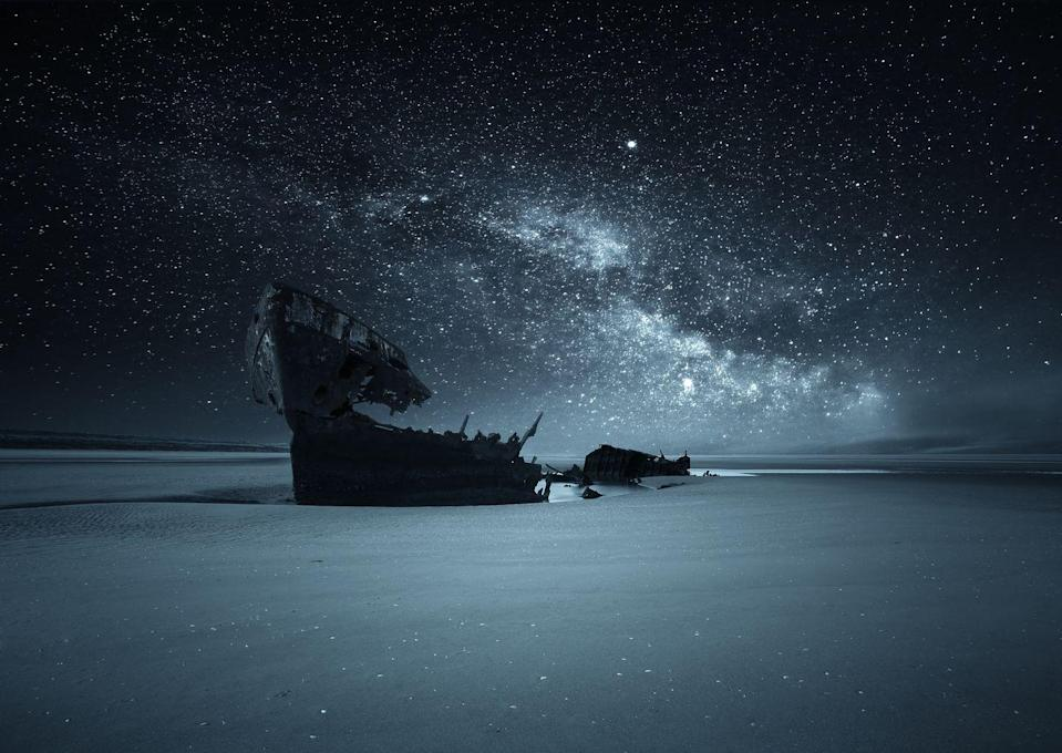 """<p>The starry night sky illuminates a shipwreck buried on a beach in Dublin, Ireland.<em><br><br><br><br><a href=""""https://subscribe.hearstmags.com/subscribe/womansday/253396?source=wdy_edit_article"""" rel=""""nofollow noopener"""" target=""""_blank"""" data-ylk=""""slk:Subscribe to Woman's Day"""" class=""""link rapid-noclick-resp"""">Subscribe to Woman's Day</a> today and get <strong>73% off your first 12 issues</strong>. And while you're at it, <a href=""""https://subscribe.hearstmags.com/circulation/shared/email/newsletters/signup/wdy-su01.html"""" rel=""""nofollow noopener"""" target=""""_blank"""" data-ylk=""""slk:sign up for our FREE newsletter"""" class=""""link rapid-noclick-resp"""">sign up for our FREE newsletter</a> for even more of the Woman's Day content you want.</em><br></p>"""