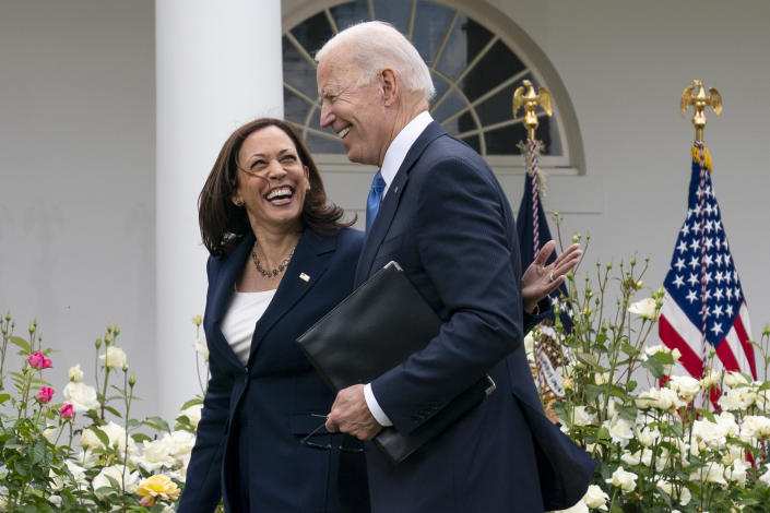 Vice President Kamala Harris and President Joe Biden smile and walk off after speaking about updated guidance on mask mandates, in the Rose Garden of the White House, Thursday, May 13, 2021, in Washington. (Evan Vucci/AP)