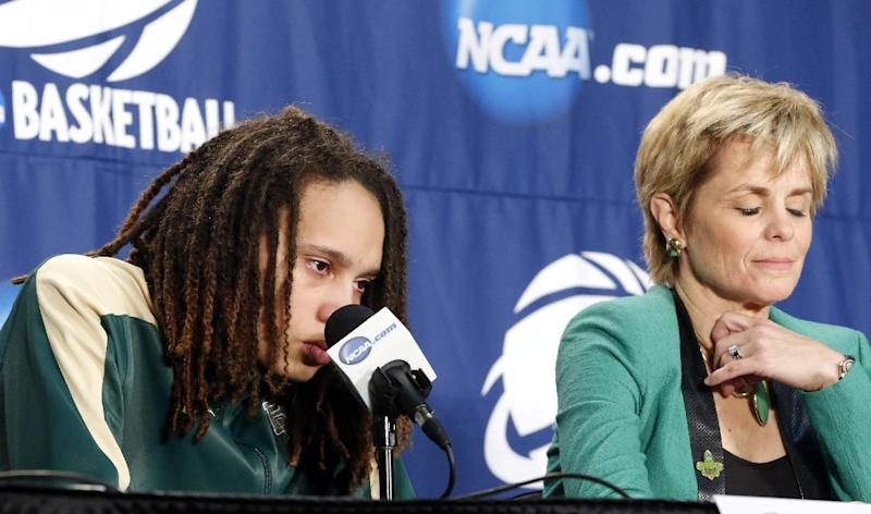 Baylor 's Brittney Griner, left, speaks during a news conference as head coach Kim Mulkey listens following their loss to Louisville in their regional semifinal game against Louisville in the women's NCAA college basketball tournament in Oklahoma City, Sunday, March 31, 2013. Louisville won 82-81. (AP Photo/Sue Ogrocki)
