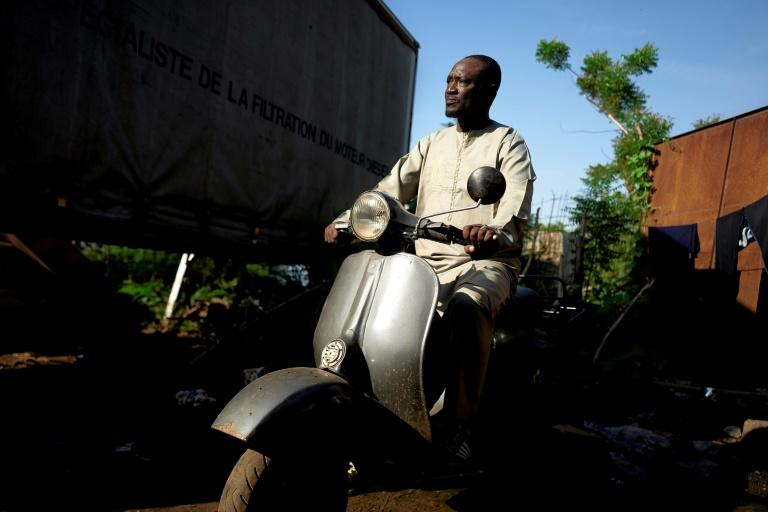 It's love: Seydou Seck and his cherished Vespa (AFP Photo/MICHELE CATTANI)