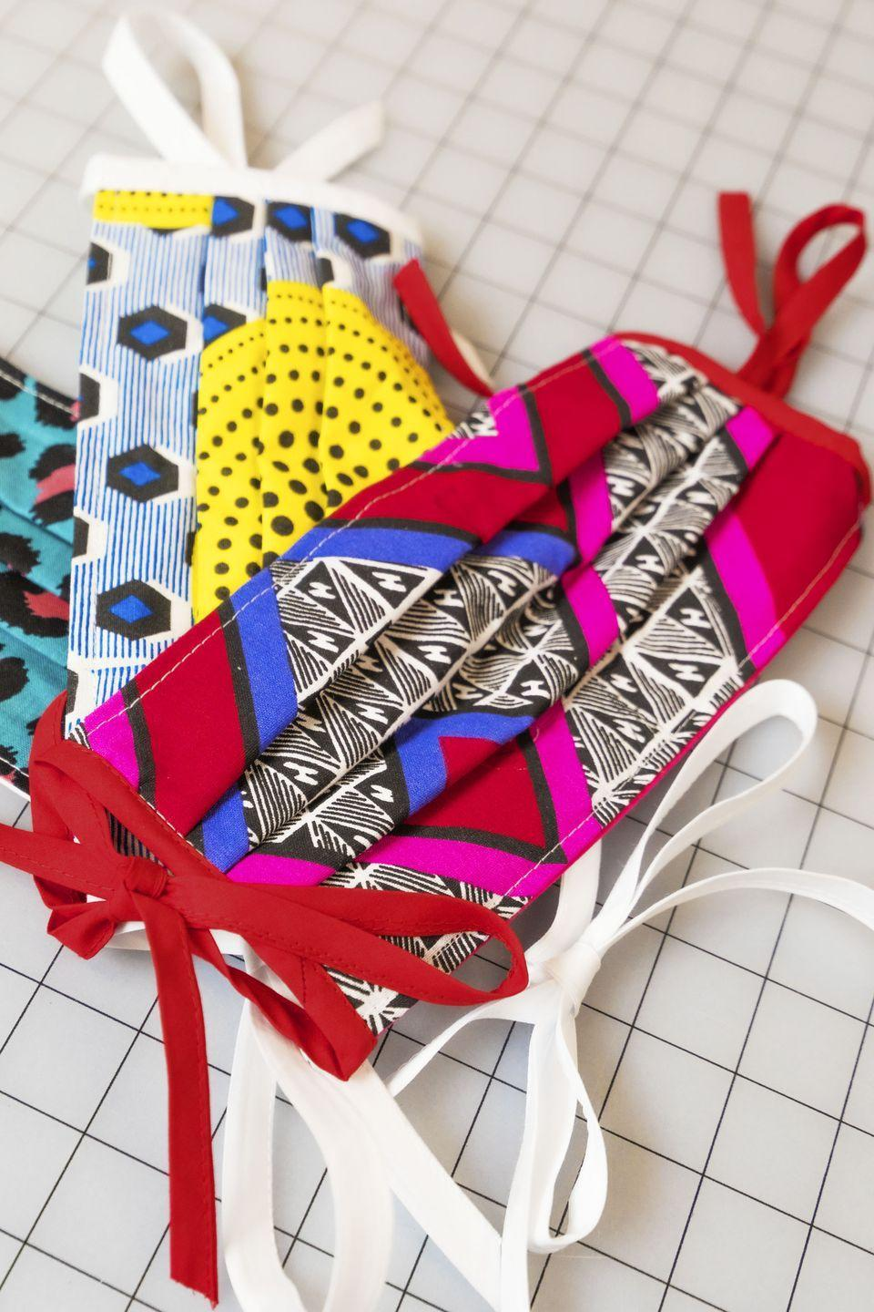 """<p>Impress Mom with your sewing skills! Make her a colorful DIY fabric mask to keep her (and others) safe when she ventures out.</p><p><em><strong>Get the tutorial at <a href=""""https://www.goodhousekeeping.com/health/a31902442/how-to-make-medical-face-masks/"""" rel=""""nofollow noopener"""" target=""""_blank"""" data-ylk=""""slk:Good Housekeeping"""" class=""""link rapid-noclick-resp"""">Good Housekeeping</a>.</strong></em></p>"""