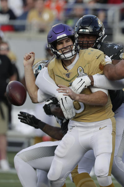 AFC defensive end Calais Campbell, of the Jacksonville Jaguars, (93) sacks NFC quarterback Kirk Cousins, of the Minnesota Vikings, and fumbles the ball, during the second half of the NFL Pro Bowl football game, Sunday, Jan. 26, 2020, in Orlando, Fla. The fumble lead to an NFC touchdown. (AP Photo/John Raoux)