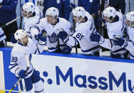 Toronto Maple Leafs left wing Nicholas Robertson (89) celebrates his first career NHL goal with teammates during the second period of an NHL hockey playoff game against the Columbus Blue Jackets Thursday, Aug. 6, 2020, in Toronto. (Nathan Denette/The Canadian Press via AP)