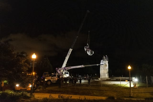 A crane removes the Christopher Columbus statue (Tyler LaRiviere/Sun-Times/AP)