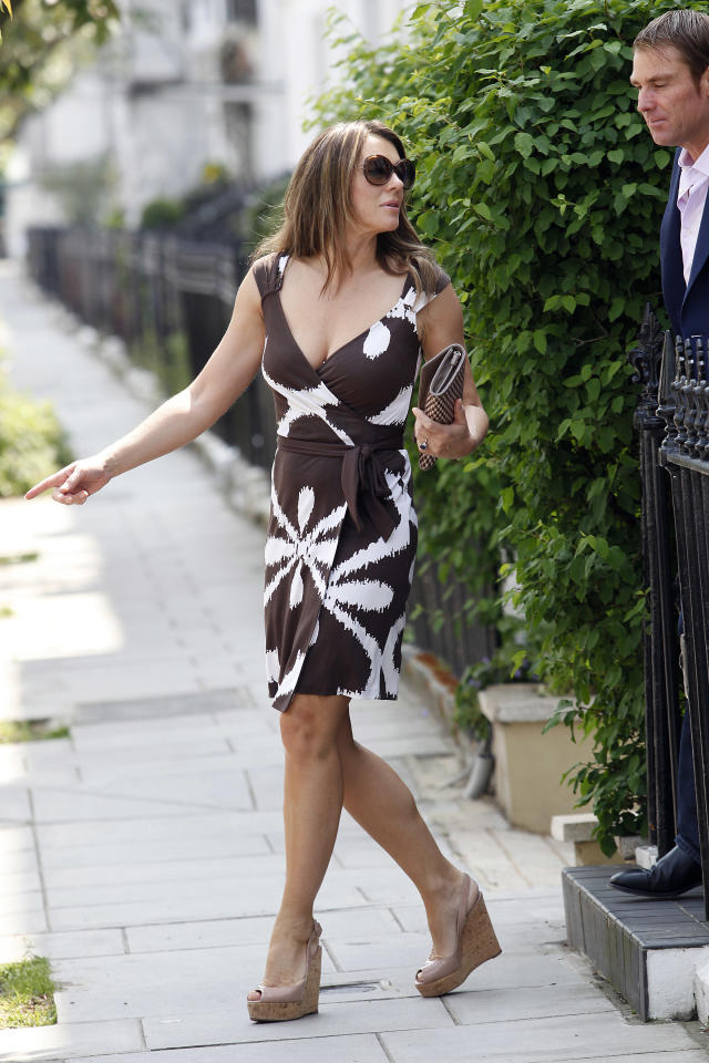 LONDON, UNITED KINGDOM - MAY 24: Elizabeth Hurley and Shane Warne are seen on May 24, 2012 in London, England. (Photo by Neil Mockford/FilmMagic)