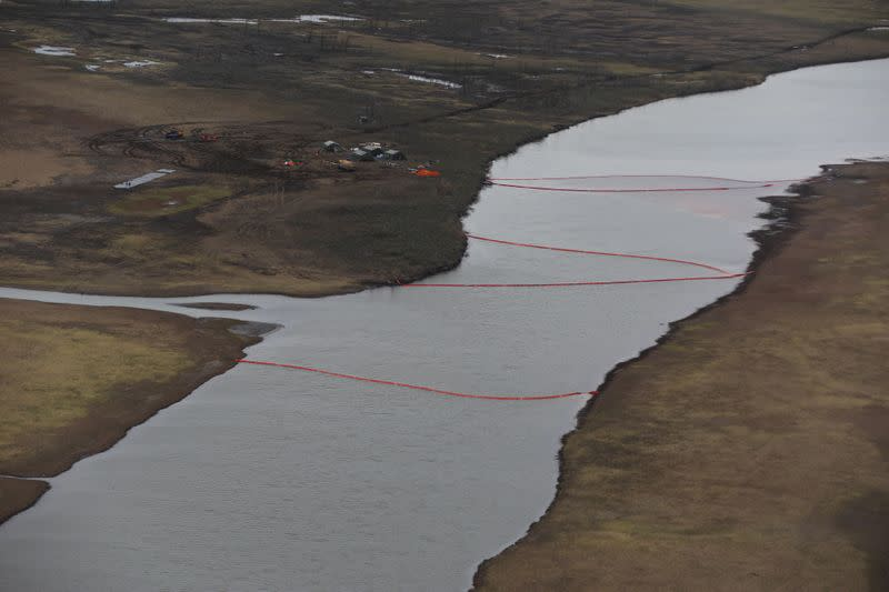 An aerial view shows a camp of rescuers and containment booms installed at the site of a huge leak of diesel fuel into the river after an accident at a power plant outside Norilsk