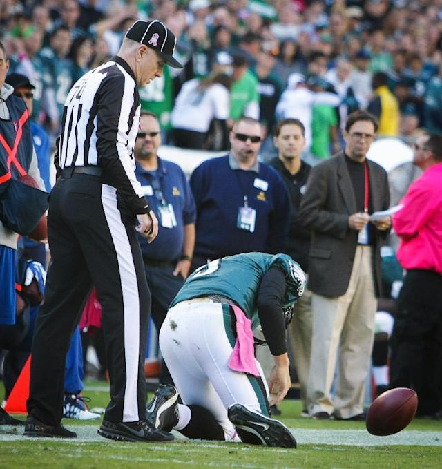 Philadelphia Eagles quarterback Nick Foles kneels near the end zone after being injured during an NFL football game against the Dallas Cowboys on Sunday, Oct. 20, 2013, in Philadelphia. (AP Photo/The Wilmington News-Journal, Suchat Pederson)
