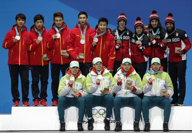 Medals Ceremony - Short Track Speed Skating Events - Pyeongchang 2018 Winter Olympics - Men's 5000m Relay - Medals Plaza - Pyeongchang, South Korea - February 23, 2018 - Gold medalists Viktor Knoch, Csaba Burjan, Liu Shaoang and Sandor Liu Shaolin of Hungary, silver medalists Wu Dajing, Han Tianyu, Xu Hongzhi and Chen Dequan of China and bronze medalists Samuel Girard, Charles Hamelin, Charle Cournoyer and Pascal Dion of Canada on the podium. REUTERS/Kim Hong-Ji