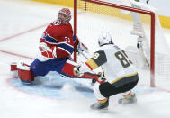 Montreal Canadiens goaltender Carey Price makes a save on Vegas Golden Knights' Alex Tuch during the third period of Game 3 of an NHL hockey semifinal series, Friday, June 18, 2021, in Montreal. (Paul Chiasson/The Canadian Press via AP)