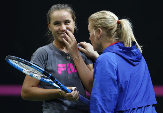 US captain Kathy Rinaldi, right, talks to Sofia Kenin, left, during a training session prior to the final match of the Fed Cup between Czech Republic and the USA in Prague, Czech Republic, Wednesday, Nov. 7, 2018. (AP Photo/Petr David Josek)