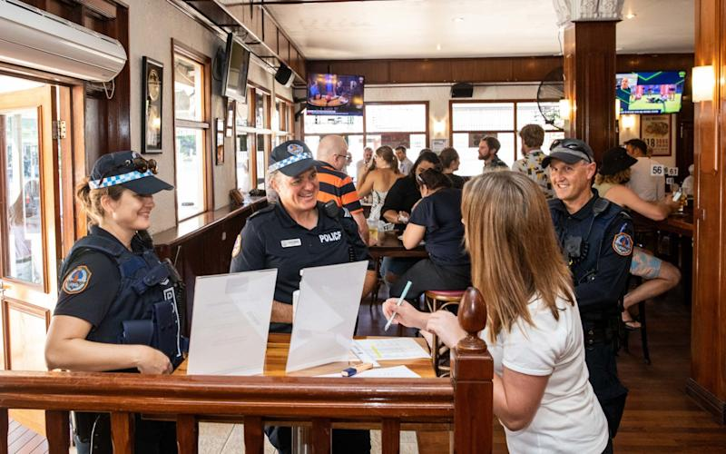 Meanwhile, in Darwin, police drop in to a local hotel after the city lifted some of its restrictions - Shutterstock