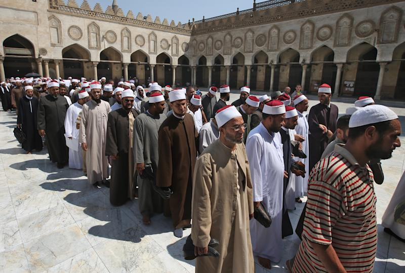 "Egyptian clerics, supporting the ousted Egyptian President Mohammed Morsi, leave al-Azhar mosque following a protest in Cairo, Egypt, Sunday, July 14, 2013. Egypt's military chief has defended the ouster of the Islamist president, saying he acted upon the will of the people after the ""stumbling"" of the former government. (AP Photo/Hussein Malla)"
