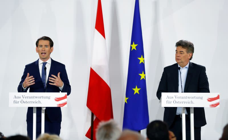 Head of Austria's Green Party Werner Kogler and head of People's Party Sebastian Kurz deliver a statement in Vienna