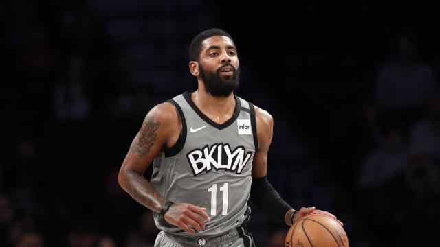 "<a class=""link rapid-noclick-resp"" href=""/nba/teams/brooklyn/"" data-ylk=""slk:Brooklyn Nets"">Brooklyn Nets</a> guard <a class=""link rapid-noclick-resp"" href=""/nba/players/4840/"" data-ylk=""slk:Kyrie Irving"">Kyrie Irving</a> (11) takes the ball down court during the first quarter of an NBA basketball game against the <a class=""link rapid-noclick-resp"" href=""/nba/teams/utah/"" data-ylk=""slk:Utah Jazz"">Utah Jazz</a>, Tuesday, Jan. 14, 2020, in New York. (AP Photo/Kathy Willens)"