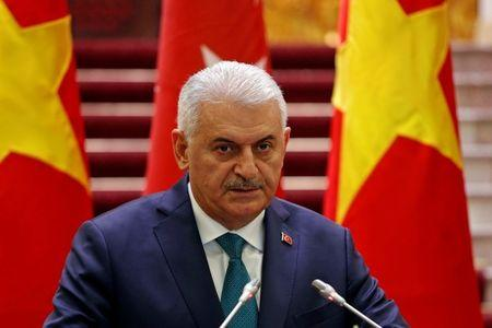 FILE PHOTO - Turkish Prime Minister Binali Yildirim attends a press briefing with his Vietnamese counterpart Nguyen Xuan Phuc at the Government Office in Hanoi
