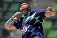 FILE - In this June 18, 2021, file photo, Ryan Crouser competes during the prelims of men's shot put at the U.S. Olympic Track and Field Trials in Eugene, Ore. A simple question of describing their track and field craft led to some creative comparisons that might help the casual track fan better understand precisely what they do at the Tokyo Games. Shot put world record holder Crouser summarized what he does for a living with an illustration. He said his event was the equivalent of picking up the heaviest bowling ball and trying to throw it the length of a basketball court. (AP Photo/Charlie Riedel, File)